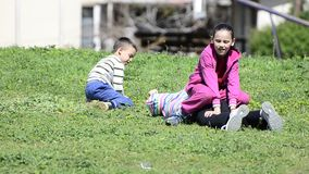 Kids playing in the grass stock video footage