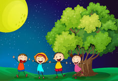 Kids playing happily near the tree Stock Image