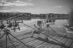 Kids playing - happy game. Angling, fishing, activity, adventure, hobby, sport. Angling child with fishing rod on wooden pier Royalty Free Stock Images