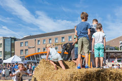 Kids playing at hay bales on a Dutch agricultural potato festival Stock Photos