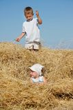 Kids playing in haystack Royalty Free Stock Images