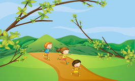 Kids playing in the hills Royalty Free Stock Photos