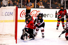 Kids playing hockey Royalty Free Stock Image