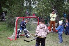 Kids playing hokey Stock Photo