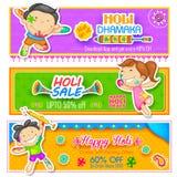 Kids playing Holi with color and pichkari Stock Photo