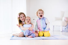 Kids playing at home, brother and sister love Stock Photo