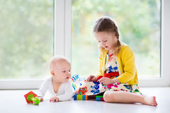 Kids playing at home royalty free stock photography