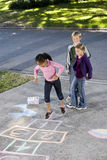 Kids playing hopscotch Royalty Free Stock Photos