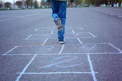Kids playing hopscotch on playground outdoors. royalty free stock photos