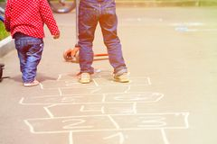 Kids playing hopscotch on playground outdoors Stock Photo