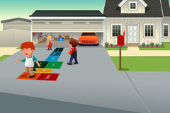 Kids playing hopscotch. A vector illustration of kids playing hopscotch on the driveway of a suburban house Stock Photos