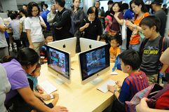 Kids playing Imac Stock Image