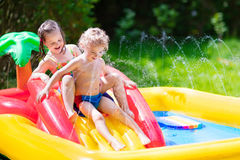 Kids playing in inflatable pool Royalty Free Stock Photos