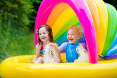 Kids playing in inflatable pool Royalty Free Stock Image