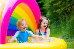 Kids playing in inflatable pool Royalty Free Stock Images