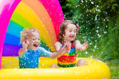 Kids playing in inflatable pool Royalty Free Stock Photography
