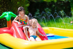 Kids playing in inflatable pool Royalty Free Stock Photo