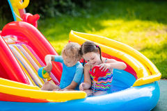 Kids playing in inflatable swimming pool Royalty Free Stock Photo