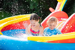 Kids playing in inflatable swimming pool Royalty Free Stock Photography