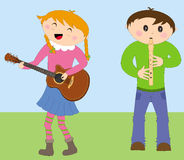 Kids playing instruments Royalty Free Stock Image