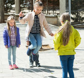 Kids playing in jump rope game Royalty Free Stock Photo