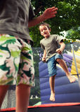 Kids playing and jumping Stock Photography