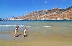Kids playing at Kamares beach Sifnos Greece royalty free stock photos