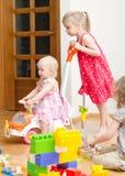 Kids playing in kindergarten Stock Image