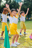 Kids playing at Kindergarten sport day. KUALA LUMPUR - 15 AUGUST 2010 :  Unidentified children performing a dance at Taman Midah Kindergarten sport day on 15 Royalty Free Stock Images