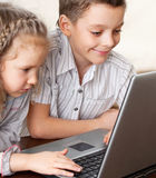 Kids playing laptop Royalty Free Stock Image