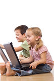 Kids playing on laptops Stock Images