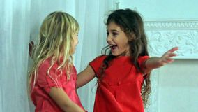 Kids playing and laughing. Young girl holding in her arms and kissing and having fun with her small sister. Kids playing and laugh stock video