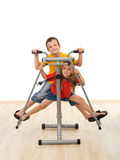 Kids playing on leg trainer fitness equipment Stock Photography