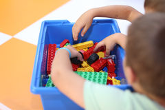 Kids playing with lego stock photography