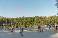 VILNIUS, LITUANIA - JULY 27, 2018: Kids Are Playing in Lukiskies Square Vilnius with Fountain and Water. Local Attraction for Chil. Kids Are Playing in Lukiskies royalty free stock image