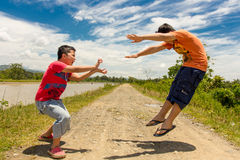 Kids playing martial arts Royalty Free Stock Images