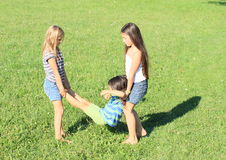 Kids playing on meadow Royalty Free Stock Image