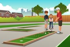 Kids Playing Mini Golf Stock Photo