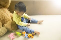 Kids are playing mobile. Royalty Free Stock Photography