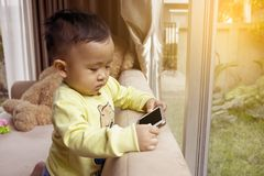 Kids are playing mobile. Royalty Free Stock Photos