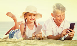 Kids playing with mobile phones Stock Photography