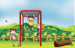 Kids playing monkey bar and a dry wood Royalty Free Stock Photos