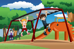 Kids playing on a monkey bar at the playground Royalty Free Stock Photography