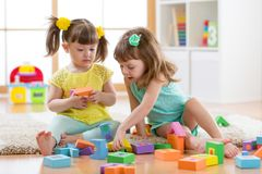 Kids are playing with montessori toys Royalty Free Stock Images