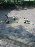 Kids playing in mud. Fish catching in India Stock Image