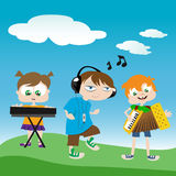 Kids playing music Stock Photography