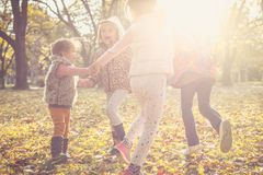 Kids playing in nature. stock photo