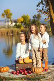 Kids playing near the lake in autumn Royalty Free Stock Image