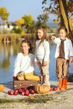 Kids playing near the lake in autumn Stock Images