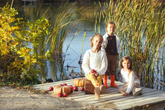 Kids playing near the lake in autumn Royalty Free Stock Photo